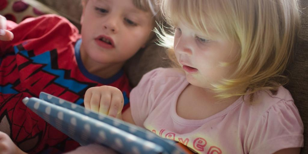 children playing on tablet