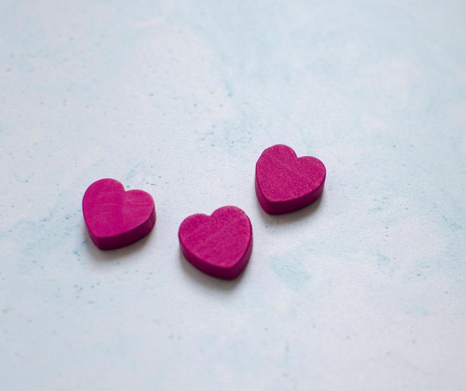 3 small pink wooden hearts