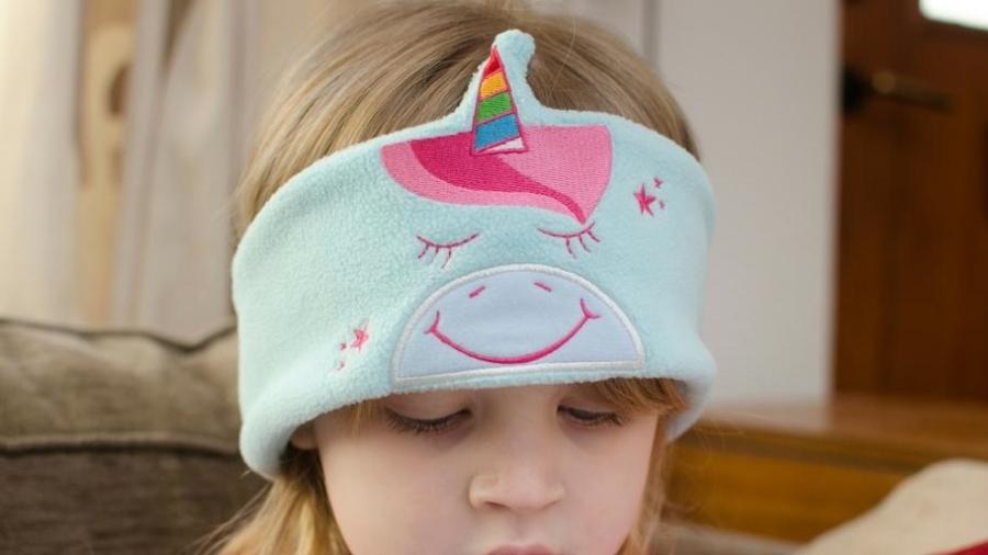 child wearing soft unicorn snuggly rascals headphones
