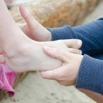Use baby talcum powder on sandy feet at the beach