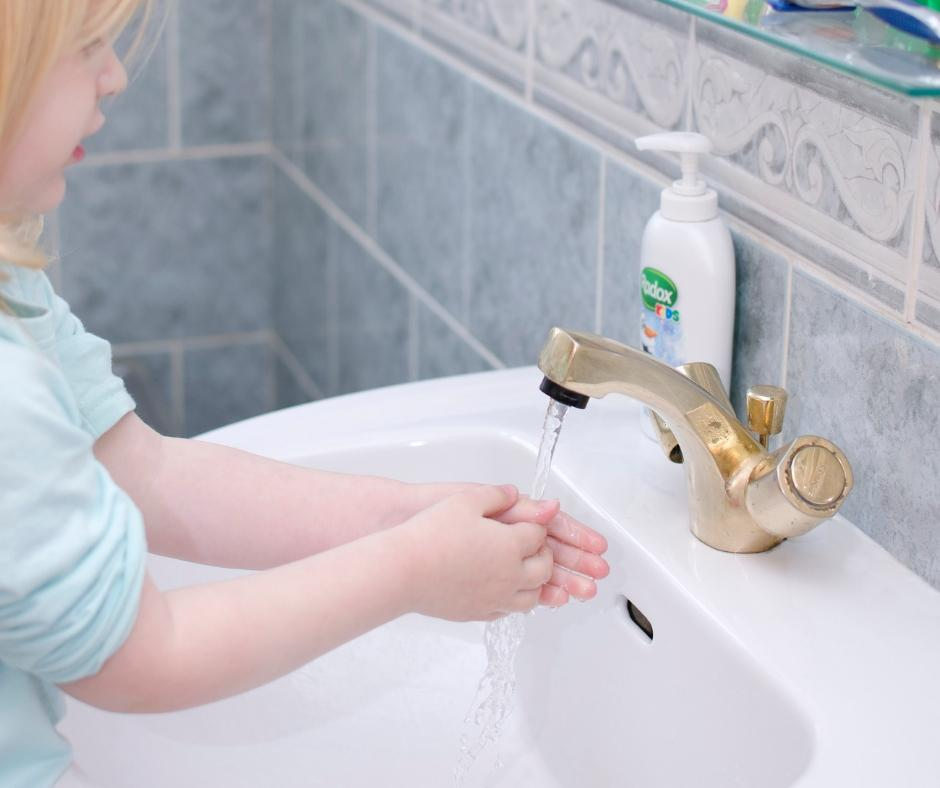 children wash hands